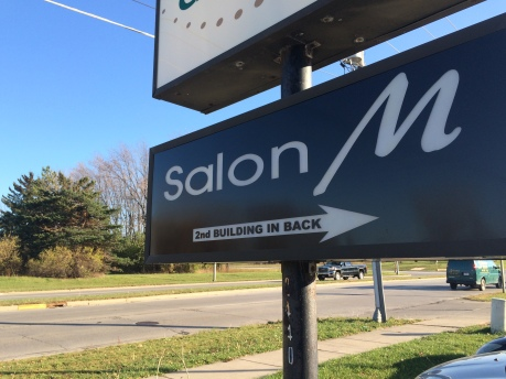 salon waukesha road sign